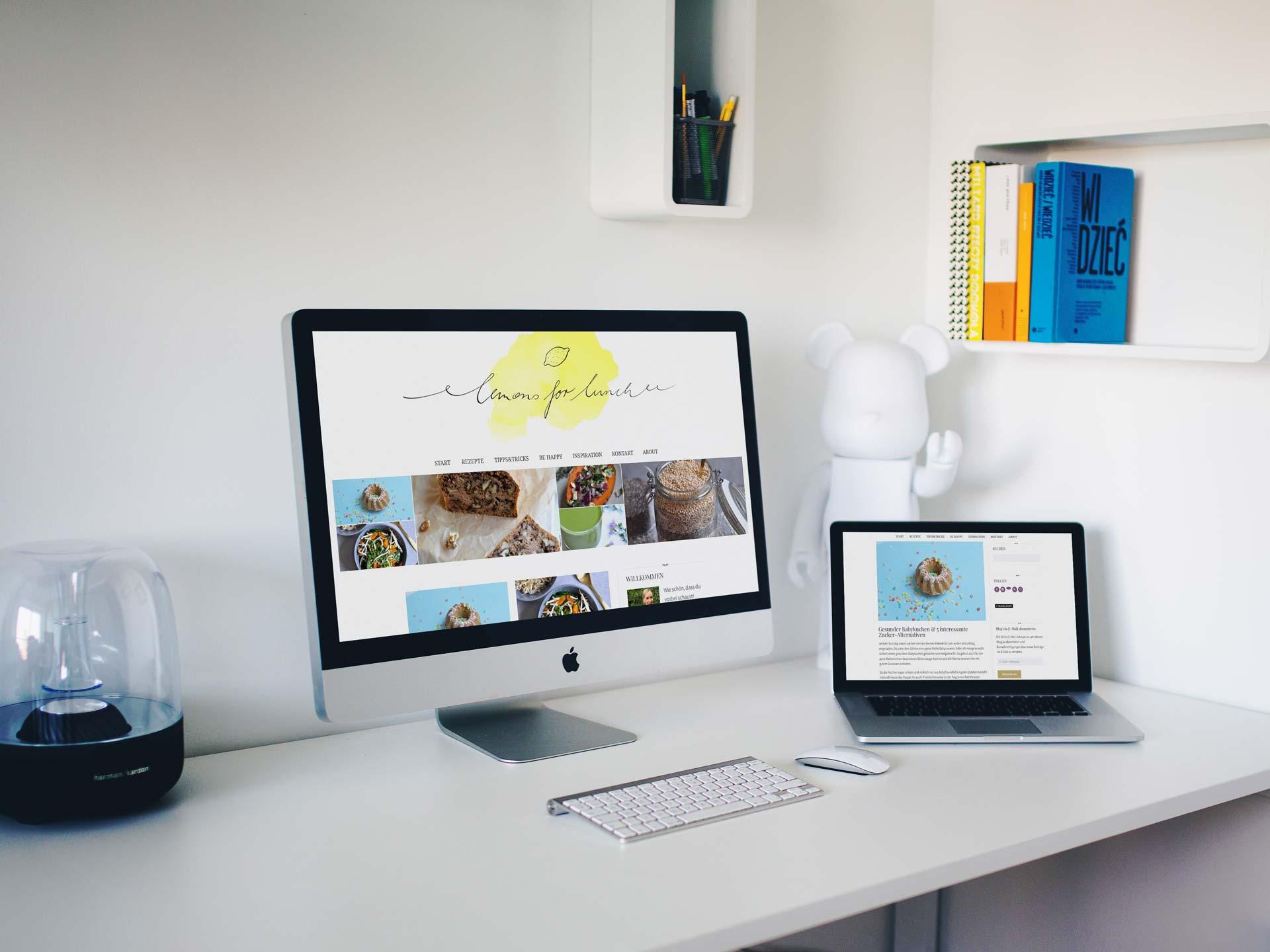 macbook und imac zeigen webseite von lemons for lunch